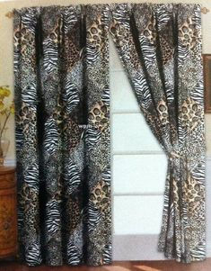 4 Piece Curtain Set: 2 Jungle Safari Black White Giraffe Zebra Panels and 2 Tie Backs by WPM. $. Color Brown. 4 piece Window Curtain Set. These Window Treatments are 1.5 inch rod pocket panels. 2 panels included. Each panel is 60 x 84  2 tie backs. Care Instruction: Machine Washable. Give your home decor style and jungle style when you decorate with these luxurious window panels. Each vivid colored curtains have a warming effect on your home window treatment while prov...