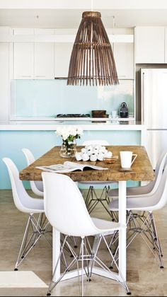 Recycled beach chic by Tim Leveson Interiors. Love the neutral-ness with a light/bright wall