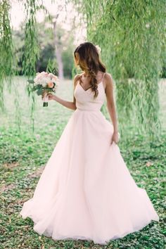 This sweet dress is from Lovely Bride DC: http://www.stylemepretty.com/2015/05/19/the-prettiest-blush-pink-wedding-dresses/
