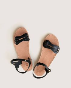 Handmade leather sandals feature subtly elegant details.