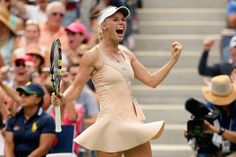 Caroline Wozniacki of Denmark celebrates match point against Maria Sharapova of Russia after winning their women's singles fourth round match on Day Seven of the 2014 US Open at the USTA Billie Jean King National Tennis Center on August 31, 2014 in the Flushing neighborhood of the Queens borough of New York City.