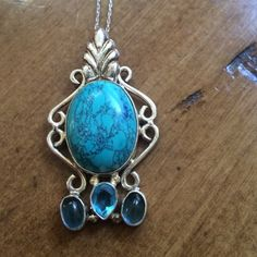 EUC silver and turquoise necklace!!! EUC silver and turquoise necklace. The chain is sterling silver and the pendent appears to be silver plated. There is a small amount of blue sharpie on the side of the stone that is shown in the third photo. Jewelry Necklaces