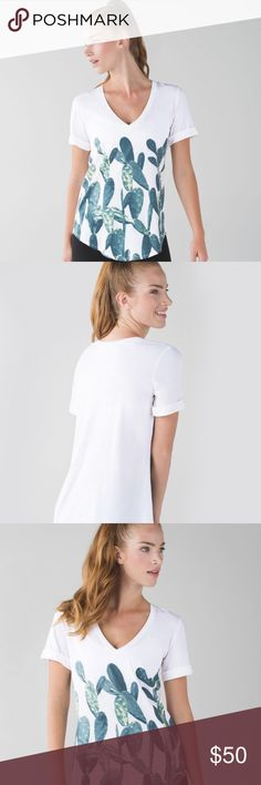Lululemon Love Tee II -White / Prickly Pear Key features Vitasea fabric is soft against your skin with added LYCRA® fibre for great shape retention you've got optionswear the sleeves down or roll them up curved hem is easy to tuck in (perfect for inversions!) designed not to shrink so there are no surprises on laundry day imported   Fit + function designed for: yoga, gym, to-and-from fabric(s):  Vitasea fit: loose length: long lululemon athletica Tops Tees - Short Sleeve