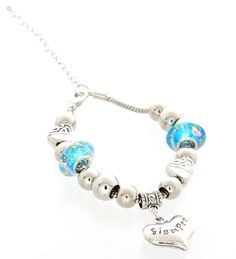 Decorated with speckled blue charms and a silver heart, this piece is the perfect accessory to any outfit