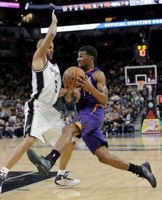 8f94d786a  SanAntonioSpurs player Tony Parker defending against the opposition  9ine San  Antonio Spurs
