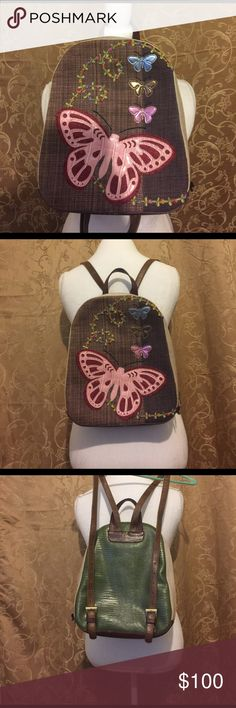"""Beautiful Spencer & Rutherford backpack purse This bag has been gently loved. And is still in excellent condition. Made in Australia. It has a fabric front Appliquéd with butterflies and flowers. Very Unique. Inside has one zip pocket on the back and two slip pockets on the front. Double butterfly zippers that meet at the top. Bag measures 12"""" tall 10"""" wide and 3"""" across the base. The straps are adjustable. Spencer & Rutherford Bags"""