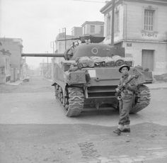 A rifleman acts as 'tail-end Charlie', guarding the commander of a Sherman tank from snipers during operations against ELAS in Athens, 18 December 1944.