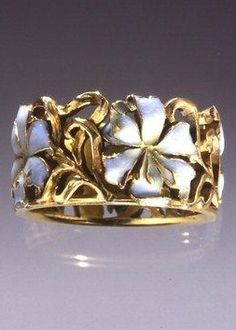 An Art Nouveau 'Fleur de Lys' ring, by René Lalique, circa 1899/1900, France…