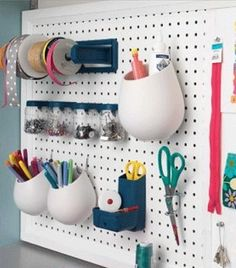 Would be fun to paint the peg board orange...Peg board organization, with the paper towel holder for the ribbons rolls