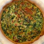 Ingredients 3 eggs 1 cup grated swiss cheese 1 pkg. frozen creamed spinach 1 pie crust Optional: sliced mushrooms, bacon bits,ham  Add everything in a bowl and stir together, add a bit of salt and pour in pie crust.  Put it in the oven at 375 degrees for about 25-30 min., but check and take out when the top is puffed up and browned.