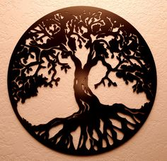 "The details of the Tree of Life wall sculpture are cut from steel with intricate precision. With a large 20"" diameter, the sturdy sculpture features a black finish and provides an enchanting focal point on any wall.    This item is made of heavy gauge steel that is cut on a CNC plasma cutter and hand finished with semi-gloss black paint. .... by bcmetalcraft"