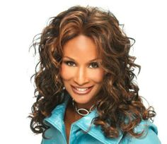 """CRUZ-V (Vivica A. Fox) - Synthetic Lace Front Wig in JET BLACK by Vivica A. Fox. $33.49. Styling required to achieve the exact look shown. Color 1 is JET BLACK. Remy Human Hair Lace Wig. Long length. Curly style. Average cap size. The color you receive may vary from the swatch shown due to your monitor and the distribution of the color fibers dictated by the style.. Color shown is FS4/30. Color 1 is JET BLACK (Color shown is FS4/30) - 20"""" LAYERED LOOSE SPIRAL CURL LACE FRONT ..."""