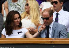 Doting wife Kate was seen tenderly stroking Prince Williams chin during the match