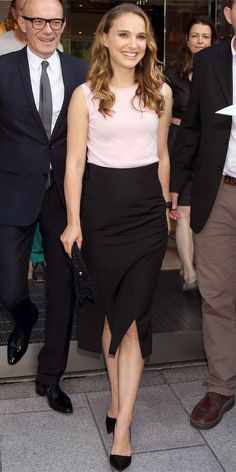 NATALIE PORTMAN, a.k.a Miss Dior, was all business in Tokyo, Japan. She tucked a blush-colored sleeveless top into a black midi-length pencil skirt that she paired with black accessories.