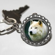 White Wolf Bottlecap Keychain. White wolf bottlecap keychain is made with a flattened bottlecap high quality photo paper and an epoxy dome. This keychain is great for Dog lovers. Bottlecap is attached to a 25mm key ring. This keychain has a White Wolf on it.