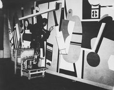 Arshile Gorky working on a mural at La Guardia Airport, for the Federal Art Project, January 1, 1937