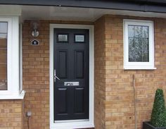 black composite door in a white upvc frame. Installed by Windseal Double Glazing based in Coventry & Warwickshire Black Composite Door, Coventry, Front Doors, Composition, Traditional, Frame, Modern, Entry Doors, Picture Frame