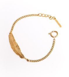 Gold Feather Bracelet | This intricately-detailed feather bracelet is made with a long... | Bracelets