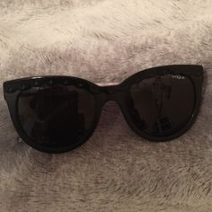 Vogue sunglasses Black cat eye vogue sunglasses very classy slightly used has a few minor dings as sheen on pic but dings not very noticeable Vogue Accessories Sunglasses