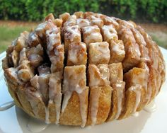 Cinnamon Roll Pulls from Plain Chicken. 1 unsliced round loaf sourdough bread; 1/2 cup butter softened; 1/4 cup powdered sugar; 1/4 cup honey; 1 tsp pure vanilla extract; 1 cup sugar; 1 1/4 tsp cinnamon; 1 cup powdered sugar; 1-2 Tbsp milk