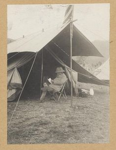 Roosevelt reading in front of his tent in hunting camp. c1910 April 4. U.S. Copyright Office.