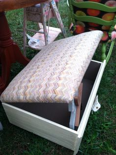 Old drawer repurposed into storage ottoman with padded lift-up top. By SUPA GUDZ.
