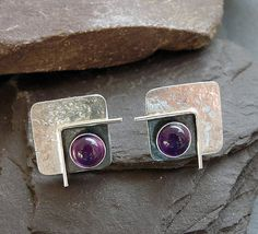 These contemporary square studs with Amethyst are completely hand made in sterling silver. They have been textured, partially oxidized and polished to a bright and shiny finish. They have sterling silver butterfly backs. Square: approximately 1.2 cm ( 0.5) x 1.2 cm ( 0.5) Amethyst: 5