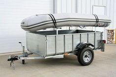 Box trailer with inflatable boat