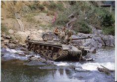 Charlie Co., 3rd Tank Battalion, crossing a river, Quang Tri. Dec. 1968. Note the Confederate flag. ~ Vietnam War