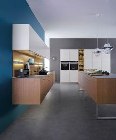 FIND OUT MORE ABOUT: Suspended kitchen furniture    A floor unit run suspended from the wall, a long isle on gliders - the furniture in this kitchen seems to float. Everything appears  light and airy, the room is open and generous in appearance.