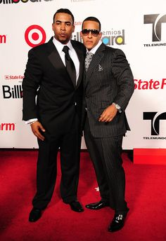 Daddy Yankee Men's Suit - Daddy Yankee wears a pinstripe suit with patent leather dress shoes to the Billboard Latin Music Awards.