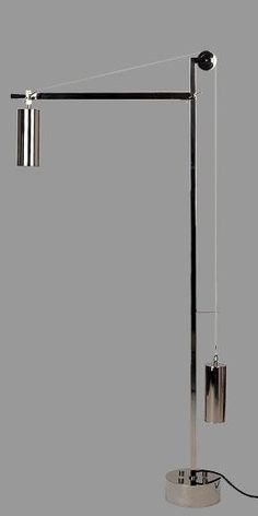 Bauhaus Floor Lamp ~ 1923    BH 23 Bauhaus floor lamp by Tecnolumen – metal nickel plated.  Impacting the world of design.  A show piece.