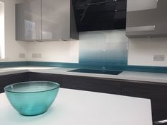 Shades of blue - printed glass kitchen splashback and upstands from Richard Osbourne's 'Kinetic Abstracts' Collection.