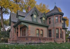 Brick Victorian home with front deck in Fort Collins, Colorado