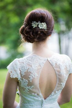 Wedding Updos That Are Beautiful From Every Angle #refinery29  http://www.refinery29.com/bridal-guide/26#slide-10  How sweet are these flowers?Related: 25+ of the Best Bridal Hairstyles...