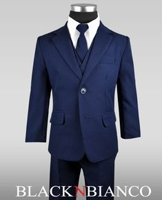 Boys Two Button Navy Suit. Modern and sleek this boys suit comes with a navy blazer, navy vest, navy tie, white dress shirt and navy slacks. Prices start at $29.99. With plent of styles to choose from this boys suit will surely impress.