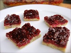 Weight Watchers Raspberry Squares. The perfect combination of sweet & tart. Terrific for raspberry lovers! 104 calories, 3 WWPP #weightwatchers #lowcalorie #dessert #recipes http://simple-nourished-living.com/2012/02/skinny-raspberry-squares/