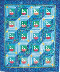 Free Quilt Patterns | Sailboats float across waves of scraps in cleverly pieced throw.