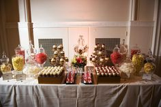Scrumptious dessert table - with candies to match the bride's colors.  I love the lollipop theme, and also think that caramel apples would look (and taste!) amazing in the fall!