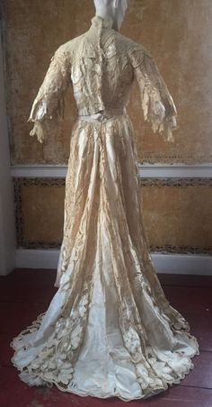 1890s Victorian Wedding Gown Battenburg Lace Silk Velvet Hearts Couture  Base of ivory white silk satin, covered in a fine, delicate white silk chiffon.  Over  the chiffon is a very fine layer of splendid Battenburg lace, complete with ivory silk and ivory silk velvet inserts for additional detail and contrast.  Battenburg lace is trimmed and accentuated with Valenciennes floral lace and pleated chiffon. Labelled by the Christianson sisters of Minneapolis. Back