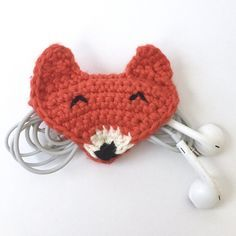 This clever and adorable fox can't wait to carry your earbuds, charger, or any other small cord you need organized. He's great for throwing in your purse so your cords don't get tangled, or keeping on your desk to tidy up your cords and make you smile! This pattern has been fully tested - my testers say it's easy and adorable! US crochet terms used throughout