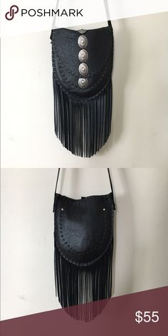 Handmade Concho Leather Bag Handmade Black leather fringe bag with silver conchos. 1 inside pocket and 1 outside pocket. This purse is handmade by me. It's one of my samples used for photo shoots and has been well used. I don't make this style anymore so I'm selling off my oldies! 8 inches wide 9 inches tall 7 inches of fringe 35 inch strap Free People tag for exposure. Free People Bags Crossbody Bags