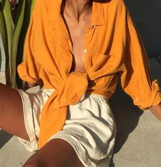 @andwhatelse LOOKING ABSOLUTELY GORGEOUS, IN HER BURNT ORANGE, LINEN BLOUSE, KNOTTED AT THE FRONT AND WORN WITH 'FAB' CREAM SHORTS! - SUPERB!