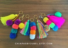 These pom-pom keychain or tassel key chains are perfect for add a colorful touch to your keys, bags, tote bag, purses, pouches.  -- You will receive exactly what you see in photos. --  Measures: -Lenght: 6,3 inches / 16 cms -Pom pom diameter: 11 cms / 4,33 inches  Made of: - Worsted yarn - Metal hook PRICE IS FOR ONE KEYCHAIN.  -- You can choose between 7 different styles --  ** 1 PIECE IN STOCK FOR EACH STYLE **  ----------------------------------------------------  IMPORTANT ABOUT…