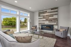 Contemporary Living Room with Clear Glass Floor Lamp, stone fireplace, Hardwood floors, Vitya Coffee Table by Uttermost