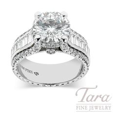 A Jack Kelege masterpiece featuring an incredible 3.02 ctw center stone, (G/SI1) cradled in a double diamond halo.  This Jack Kelege engagement ring also features a wide band set with 3 rows of diamonds.  Twenty baguettes, 1.30 tdw, and 82 round diamonds, .79 tdw, grace each of its sides.  Tara Fine Jewelry Company, Atlanta.