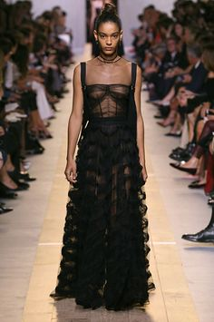 Black quilted cotton vest with embroidered black tulle long dress with black knitted underwear. Dior