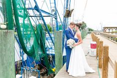 Some couples make their exit by car or by horse and carriage, but Casey and Kyle took it to the water and boarded a boat!