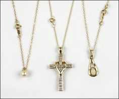 A TEN KARAT YELLOW GOLD AND DIAMOND CROSS NECKLACE. Lot 150-7079 #jewelry