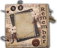 A vintage mini-album with lots of different papers and embellishments.